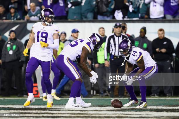 Adam Thielen Latavius Murray and Stefon Diggs of the Minnesota Vikings celebrate the first quarter touchdown by Kyle Rudolph against the Philadelphia...