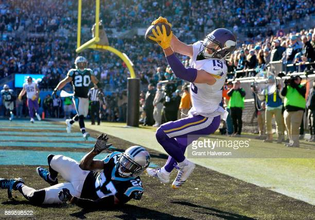 Adam Thielen of the Minnesota Vikings attempts a catch against Kevon Seymour of the Carolina Panthers in the second quarter during their game at Bank...
