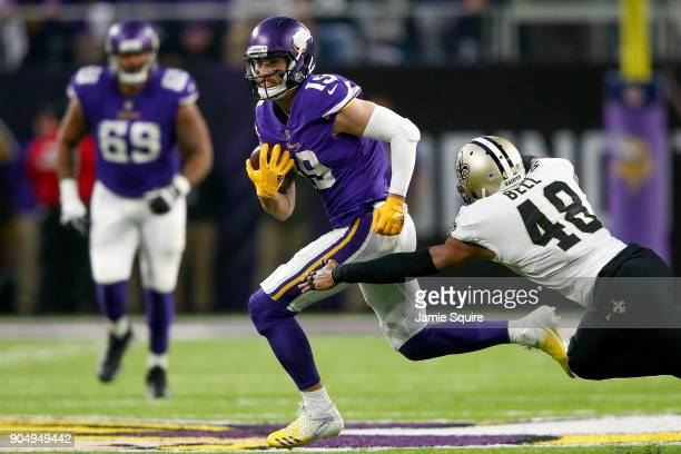 Adam Thielen of the Minnesota Vikings breaks a tackle from Vonn Bell of the New Orleans Saints during the first half of the NFC Divisional Playoff...