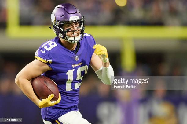 Adam Thielen of the Minnesota Vikings carries the ball against the Green Bay Packers during the game at US Bank Stadium on November 25 2018 in...