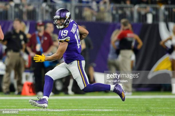 Adam Thielen of the Minnesota Vikings carries the ball against the New Orleans Saints during the game on September 11 2017 at US Bank Stadium in...