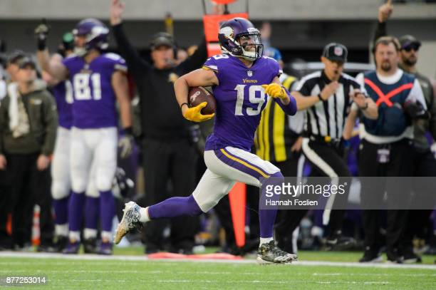 Adam Thielen of the Minnesota Vikings carries the ball against the Los Angeles Rams during the game on November 19 2017 at US Bank Stadium in...