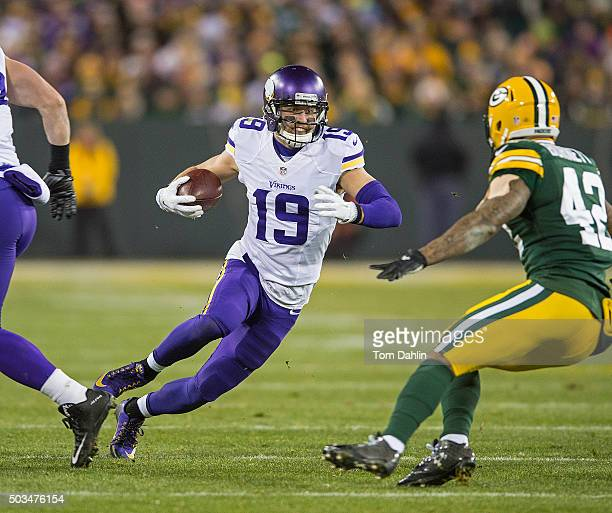 Adam Thielen of the Minnesota Vikings carries the ball during an NFL game against the Green Bay Packers at Lambeau Field January 3 2016 in Green Bay...