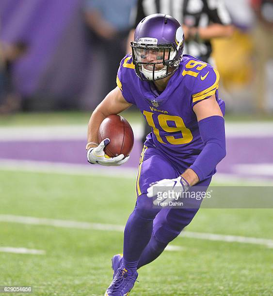 Adam Thielen of the Minnesota Vikings carries the ball during an NFL game against the Dallas Cowboys at US Bank Stadium December 1 2016 in...