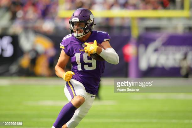 Adam Thielen of the Minnesota Vikings carries the ball in the second half of the game against the San Francisco 49ers at US Bank Stadium on September...
