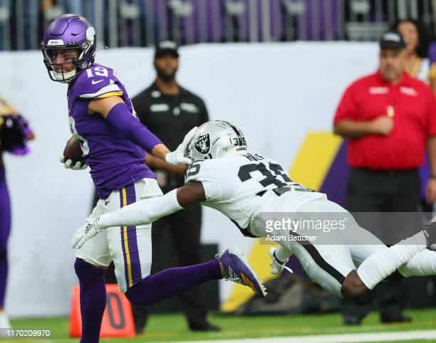 Adam Thielen of the Minnesota Vikings catches a 35 yard pass for a touchdown in the first quarter against the Oakland Raiders at U.S. Bank Stadium on...
