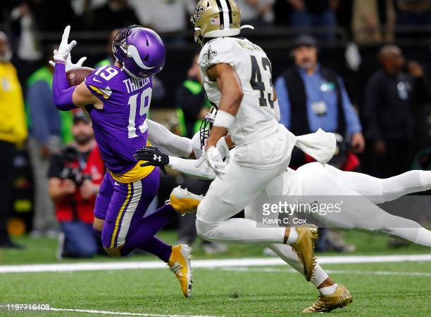 Adam Thielen of the Minnesota Vikings catches a 43-yard pass during overtime against the New Orleans Saints in the NFC Wild Card Playoff game at...