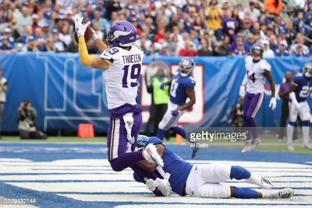 Adam Thielen of the Minnesota Vikings catches a third Quarter Touchdown against Deandre Baker of the New York Giants during their game at MetLife...