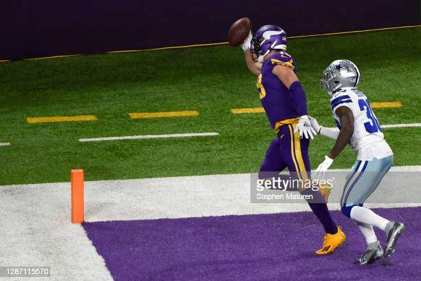 Adam Thielen of the Minnesota Vikings catches a touchdown pass against Anthony Brown of the Dallas Cowboys in the third quarter during their game at...
