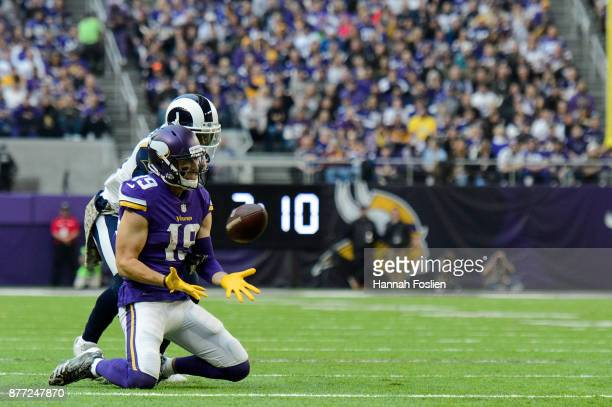 Adam Thielen of the Minnesota Vikings catches the ball against Kayvon Webster of the Los Angeles Rams during the game on November 19 2017 at US Bank...