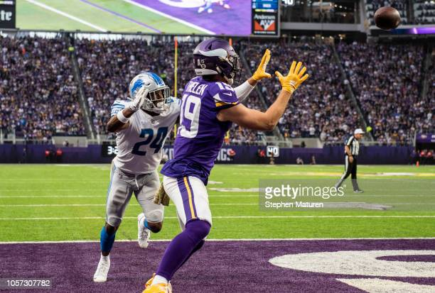 Adam Thielen of the Minnesota Vikings catches the ball for a touchdown in the second quarter of the game against the Detroit Lions at US Bank Stadium...