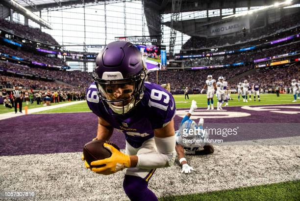Adam Thielen of the Minnesota Vikings catches the ball for a touchdown in the second quarter of the game against the Detroit Lions at U.S. Bank...