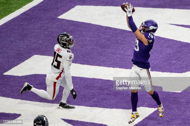 Adam Thielen of the Minnesota Vikings catches the ball for a touchdown in the fourth quarter of the game against the Atlanta Falcons at U.S. Bank...