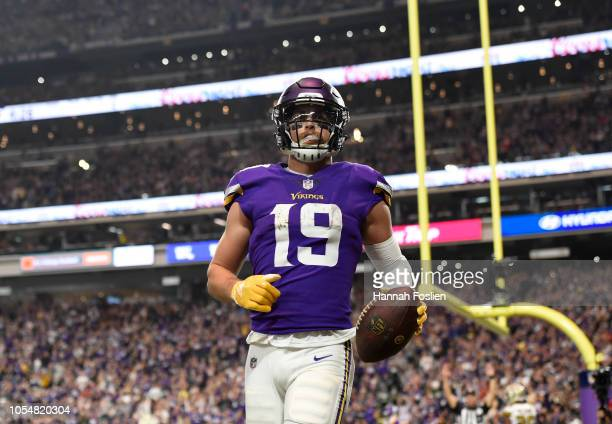 Adam Thielen of the Minnesota Vikings catches the ball in the end zone for a touchdown in the fourth quarter of the game against the New Orleans...