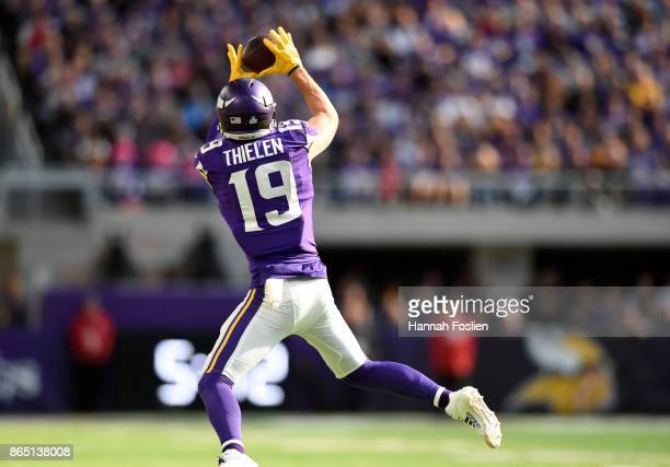 Adam Thielen of the Minnesota Vikings catches the ball in the second half of the game against the Baltimore Ravens on October 22 2017 at US Bank...