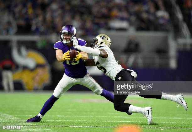 Adam Thielen of the Minnesota Vikings catches the ball on the sideline in the second half of the game against the New Orleans Saints on September 11...