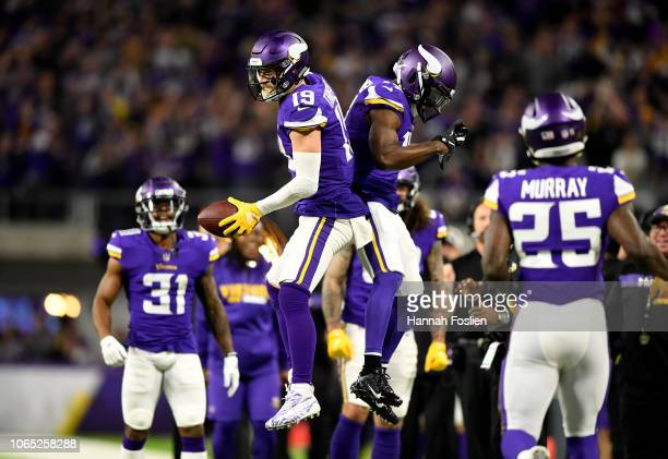 Adam Thielen of the Minnesota Vikings celebrates after a 14 yard touchdown reception in the third quarter of the game against the Green Bay Packers...