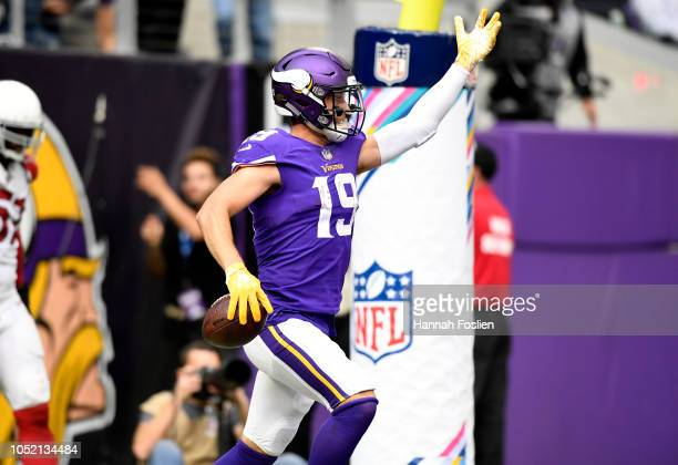 Adam Thielen of the Minnesota Vikings celebrates after scoring a touchdown in the third quarter of the game against the Arizona Cardinals at US Bank...