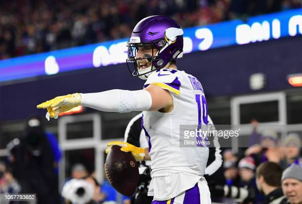 Adam Thielen of the Minnesota Vikings celebrates after scoring a touchdown during the second quarter against the New England Patriots at Gillette...