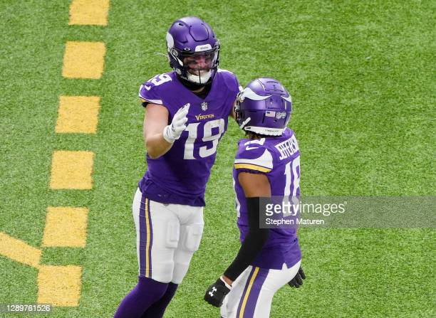 Adam Thielen of the Minnesota Vikings celebrates his touchdown with teammate Justin Jefferson in the second quarter against the Jacksonville Jaguars...