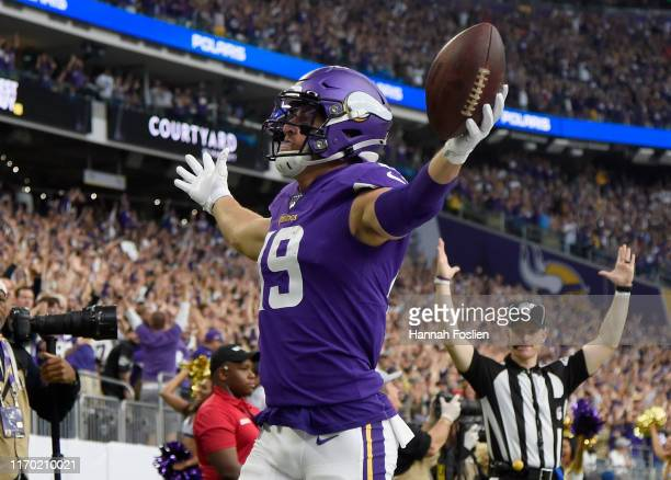 Adam Thielen of the Minnesota Vikings celebrates scoring a touchdown against the Oakland Raiders during the first quarter of the game at U.S. Bank...
