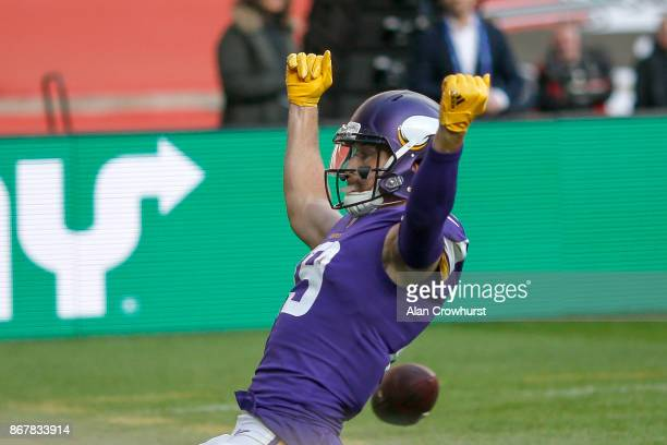 Adam Thielen of the Minnesota Vikings celebrates scoring a touchdown during the NFL International Series match between Minnesota Vikings and...