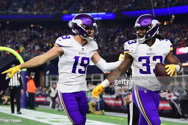 Adam Thielen of the Minnesota Vikings celebrates with Dalvin Cook after scoring a touchdown during the second quarter against the New England...