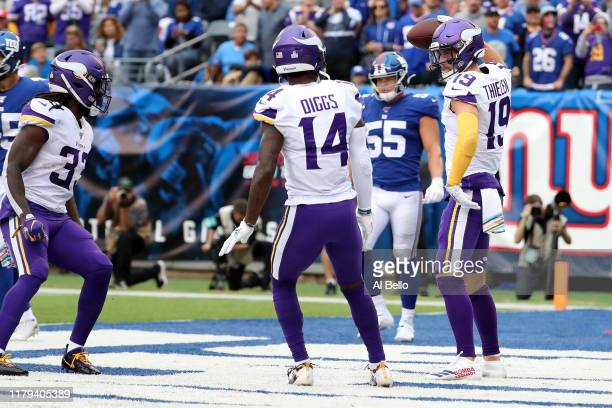 Adam Thielen of the Minnesota Vikings celebrates with his teammates after scoring a 15 yard touchdown against the New York Giants during the second...