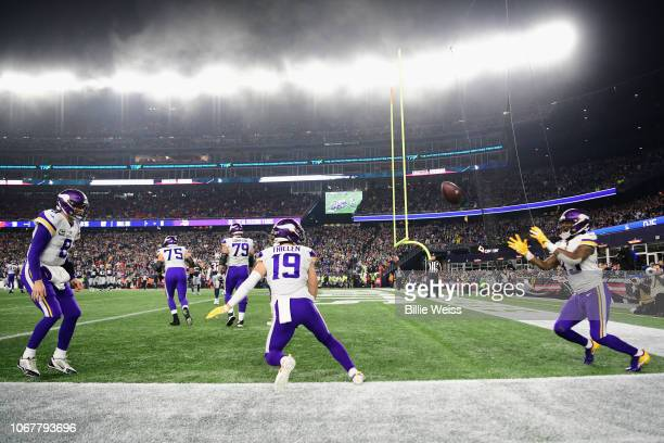 Adam Thielen of the Minnesota Vikings celebrates with Kirk Cousins and Dalvin Cook after scoring a touchdown during the second quarter against the...