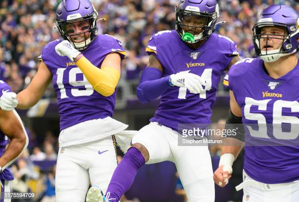 Adam Thielen of the Minnesota Vikings celebrates with teammate Stefon Diggs after scoring a touchdown in the first quarter of the game against the...