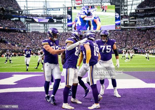 Adam Thielen of the Minnesota Vikings celebrates with teammates after scoring a touchdown in the first quarter of the game against the Atlanta...