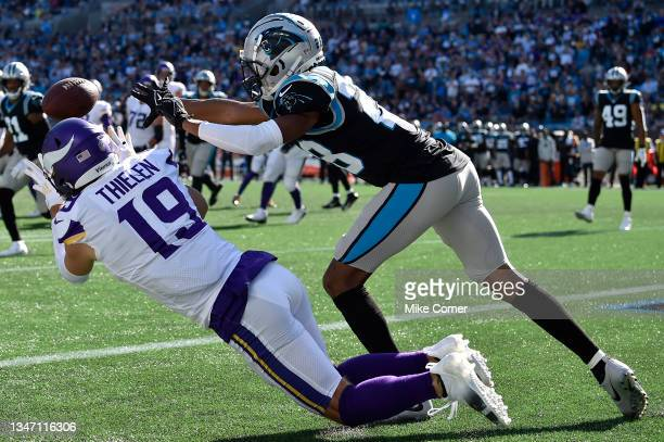 Adam Thielen of the Minnesota Vikings dives for a touchdown reception against Keith Taylor Jr. #28 of the Carolina Panthers during the third quarter...