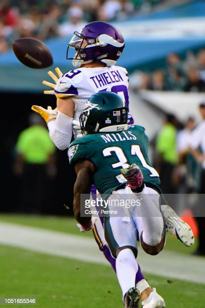 Adam Thielen of the Minnesota Vikings hauls in a reception against Jalen Mills of the Philadelphia Eagles during the third quarter at Lincoln...