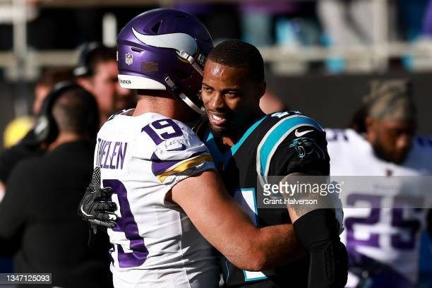 Adam Thielen of the Minnesota Vikings hugs A.J. Bouye of the Carolina Panthers after the game at Bank of America Stadium on October 17, 2021 in...