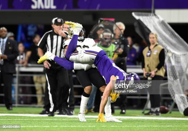 Adam Thielen of the Minnesota Vikings is flipped upside down after catching the ball in the first half of the NFC Divisional Playoff game against the...