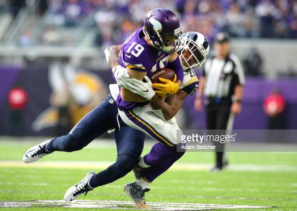 Adam Thielen of the Minnesota Vikings is tackled with the ball by Trumaine Johnson of the Los Angeles Rams in the first half of the game on November...