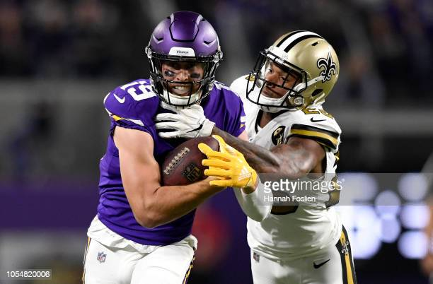 Adam Thielen of the Minnesota Vikings is tackled with the ball by PJ Williams of the New Orleans Saints in the fourth quarter of the game at US Bank...