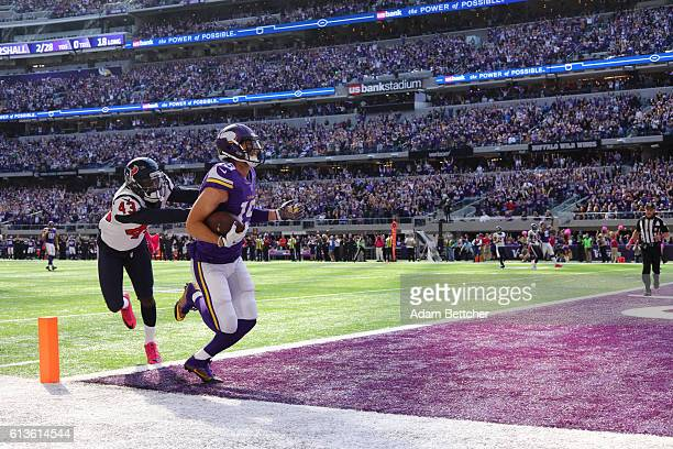 Adam Thielen of the Minnesota Vikings makes a catch to score a touchdown in the first quarter against the Houston Texans on October 9 2016 at US Bank...
