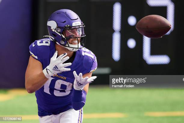 Adam Thielen of the Minnesota Vikings makes a reception for a two-point conversion against the Green Bay Packers during the game at U.S. Bank Stadium...