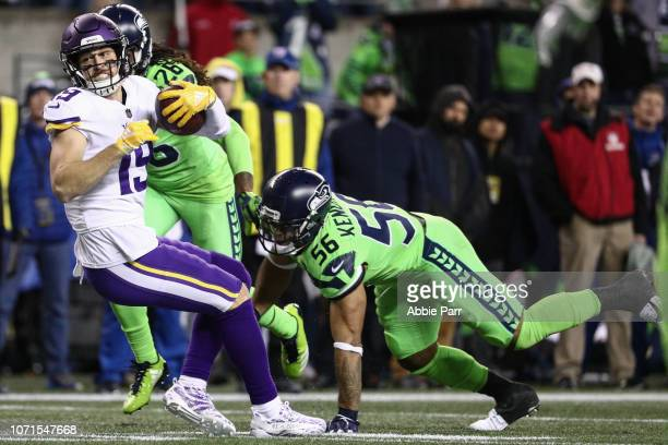 Adam Thielen of the Minnesota Vikings makes his 100th catch of the season over Mychal Kendricks of the Seattle Seahawks in the fourth quarter at...