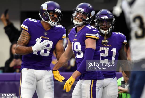Adam Thielen of the Minnesota Vikings Michael Floyd and Jerick McKinnon celebrate after scoring a touchdown in the fourth quarter of the game against...
