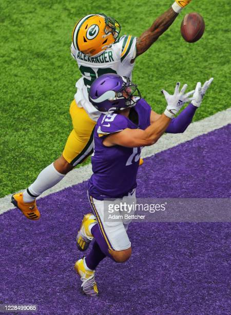 Adam Thielen of the Minnesota Vikings pulls in a pass for a touchdown against coverage by Jaire Alexander of the Green Bay Packers in the fourth...