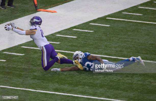 Adam Thielen of the Minnesota Vikings reaches for a pass as Kenny Moore II of the Indianapolis Colts defends during the first half at Lucas Oil...