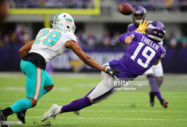 Adam Thielen of the Minnesota Vikings reaches out to catch the ball in the first quarter of the game against the Miami Dolphins at US Bank Stadium on...