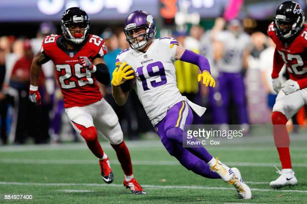 Adam Thielen of the Minnesota Vikings runs after a catch during the second half against the Atlanta Falcons at MercedesBenz Stadium on December 3...