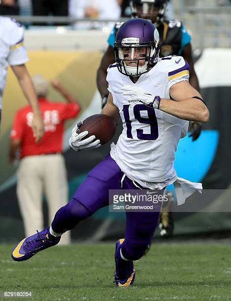 Adam Thielen of the Minnesota Vikings runs after catching a pass during the game against the Jacksonville Jaguars at EverBank Field on December 11...