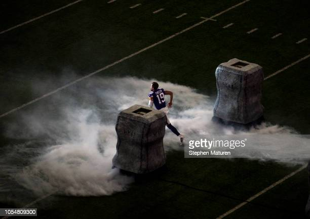 Adam Thielen of the Minnesota Vikings runs out of the tunnel during pregame introductions before the game against the New Orleans Saints at US Bank...