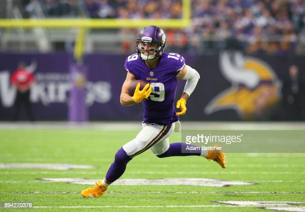 Adam Thielen of the Minnesota Vikings runs with the ball after catching a pass in the first quarter of the game against the Cincinnati Bengals on...