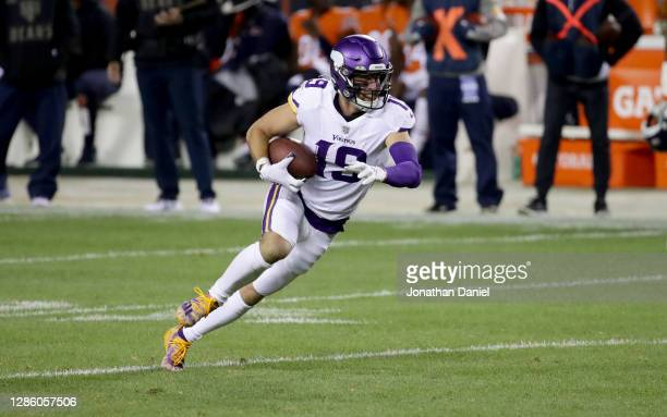 Adam Thielen of the Minnesota Vikings runs with the ball after a pass reception against the Chicago Bears at Soldier Field on November 16, 2020 in...