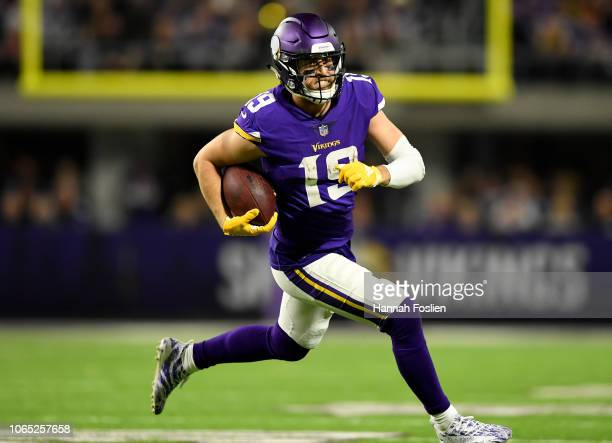 Adam Thielen of the Minnesota Vikings runs with the ball after making a catch in the third quarter of the game against the Green Bay Packers at US...